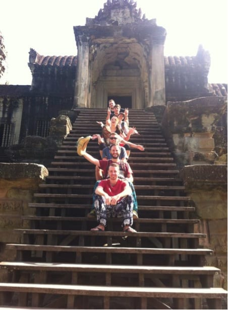 Cambodia - group sitting on temple steps