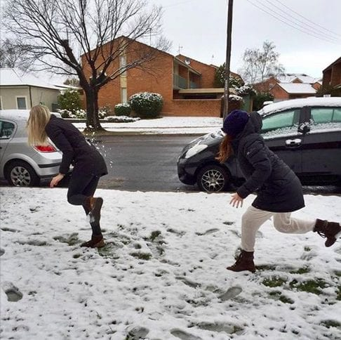Bridget and Sophie in a snowball fight