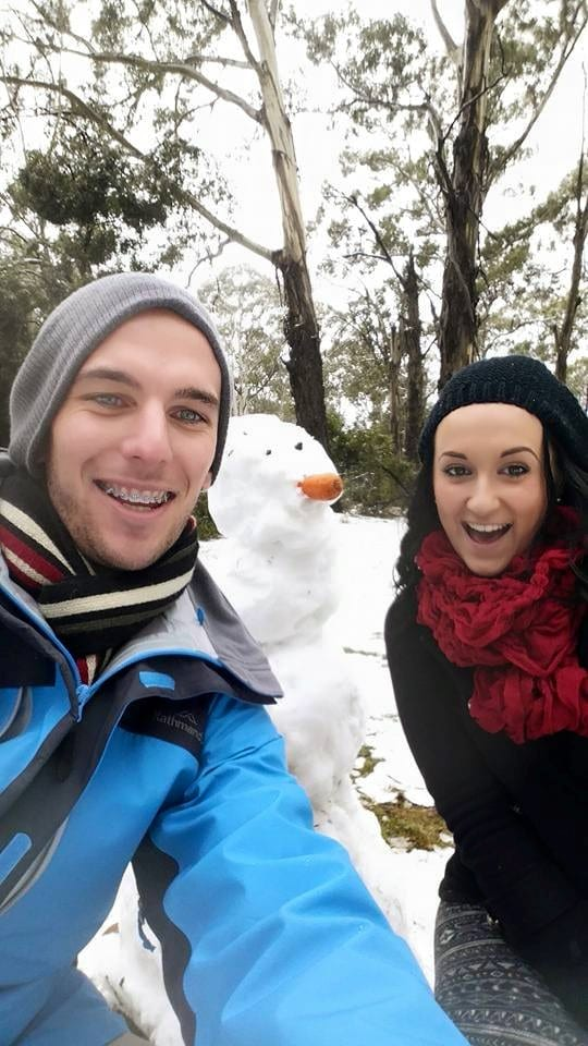 Stuart and Naida with a snowman