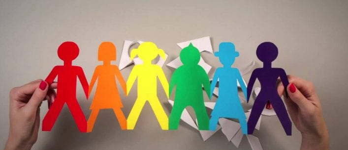 Joined paper dolls in different colours and shapes