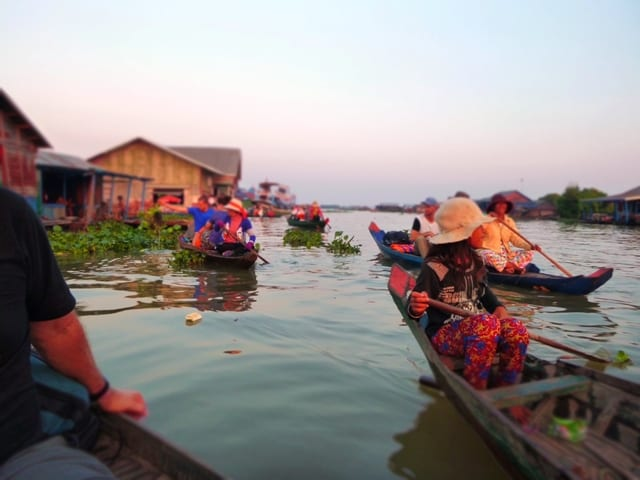 colourful cambodian river image with boats