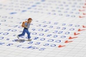 Toy figure walking across a notebook