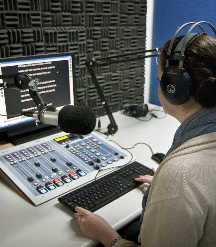 student in radio newsroom