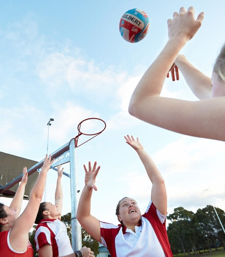 CSU students in uniform playing netball