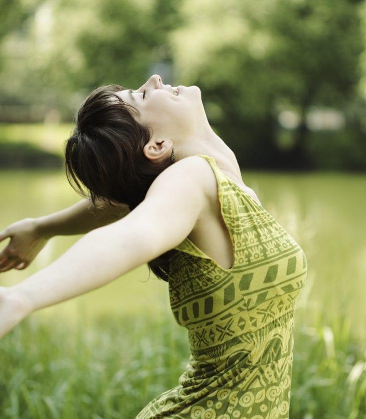 girl in green dress enjoying the outdoors