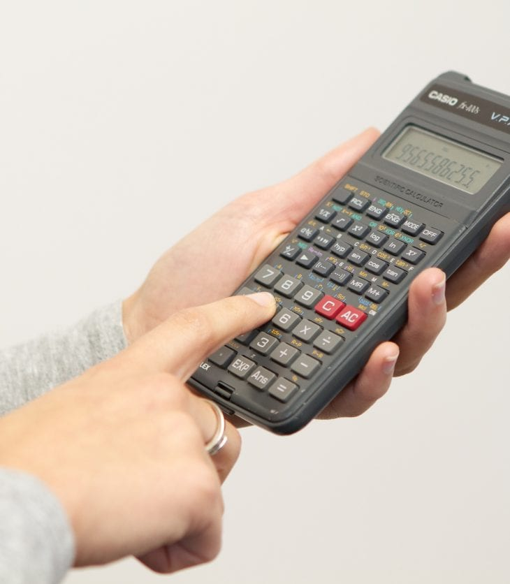 image of hands and person using calculator
