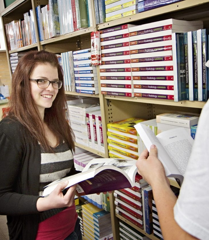 image of students in the bookshop on campus