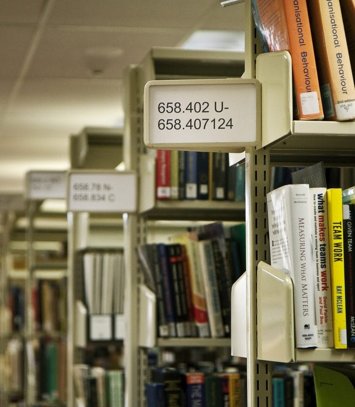 image of shelves of books in the library