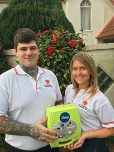 Daniel Steinbeck with defibrillator as part of Student Heart Project