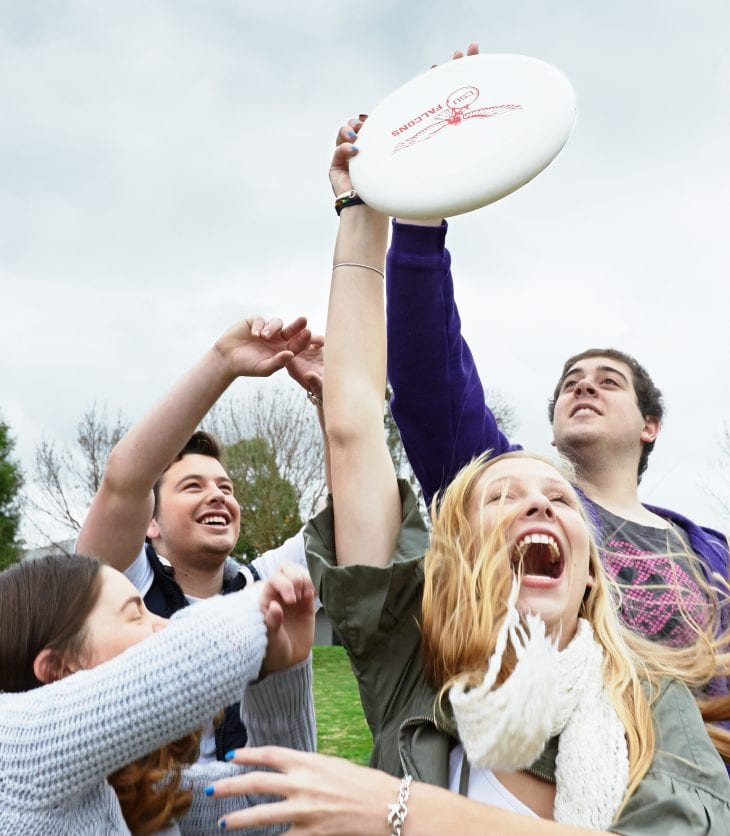 students playing with a frisbee