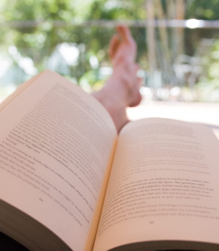 Person relaxing reading a book