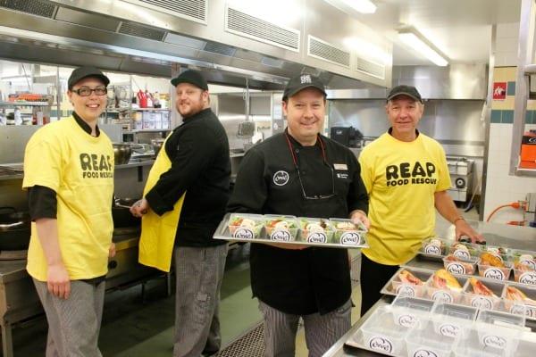 CSU Cheer staff cook up left over food