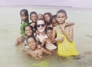 Catreena Kuhn and local children