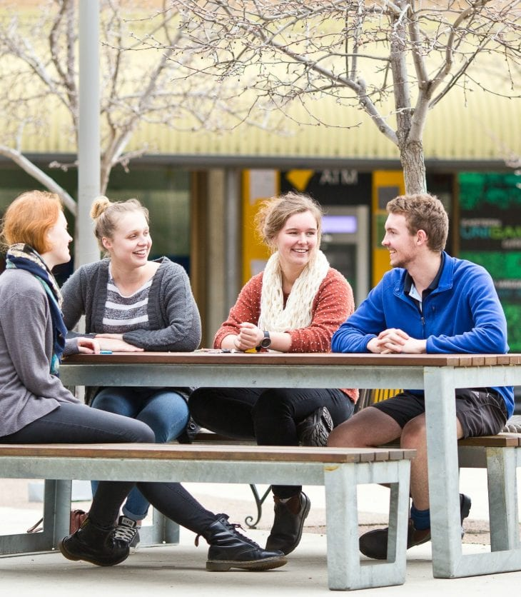 CSU students in Wagga Wagga sit and eat in the cafe eating area.