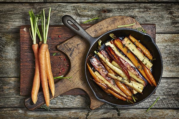 Grilled carrots in a frying pan.
