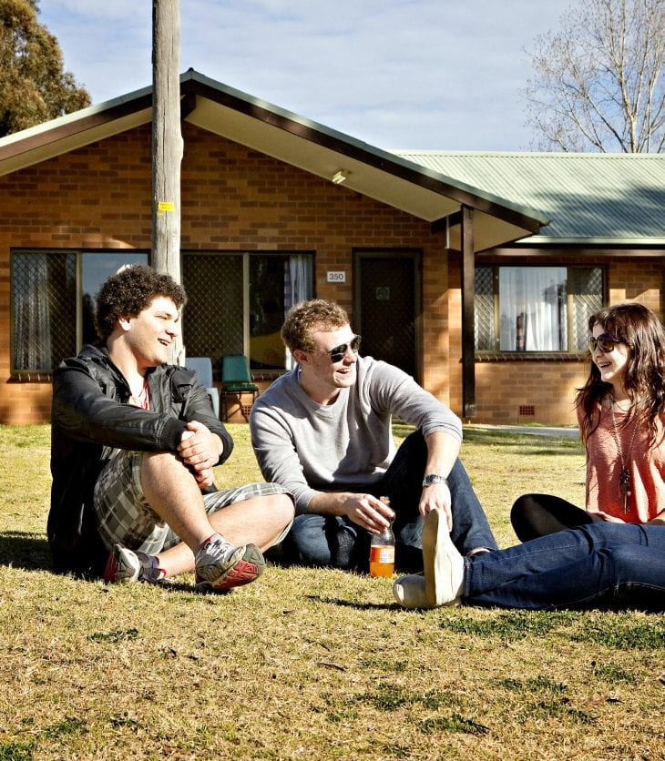Students sitting outside campus accommodation