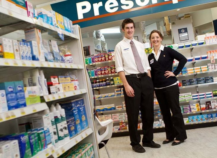 two young people in a pharmacy