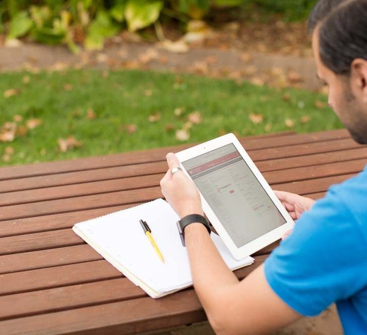 male student looking at CSU page on an iPad