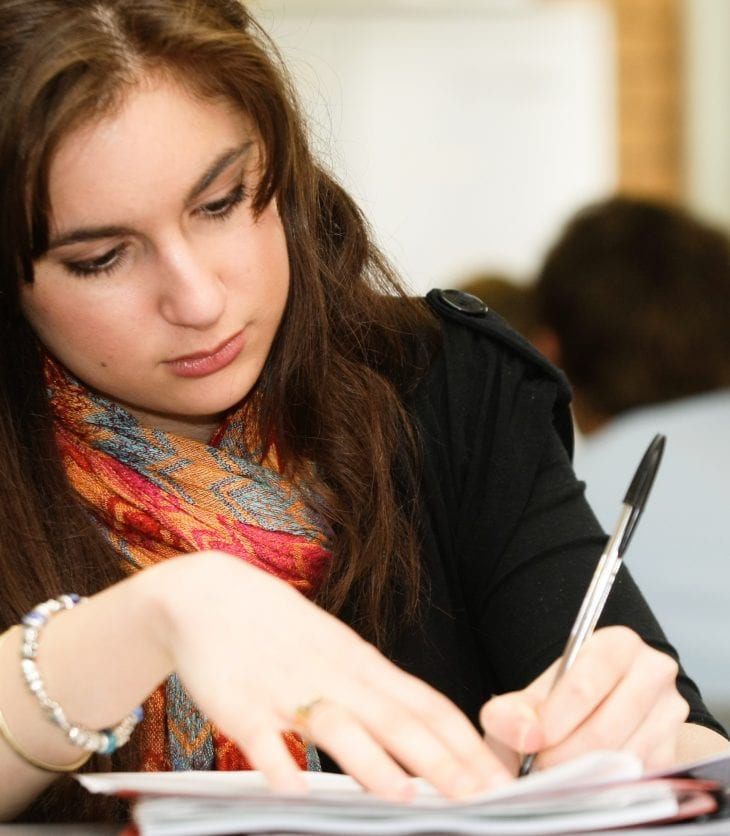Female student sitting exam