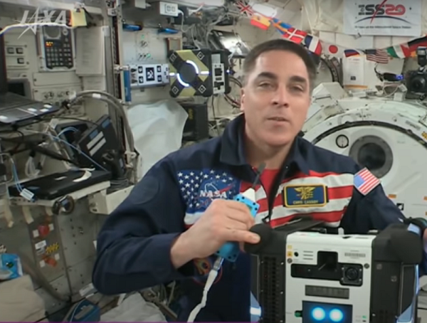 Astronaut Chris Cassidy speaks to the competition finalists from the International Space Station